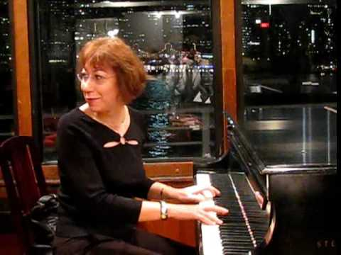 Elena Kuschnerova testing piano at Barge Music