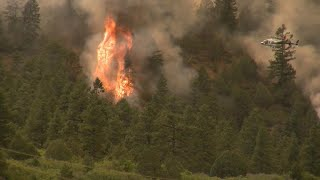 Threat of storms could complicate fight against raging wildfires in West