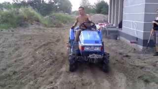 Iseki TU 155 mini ciągnik ogrodniczy z kultywatorem. www.traktorki-japonskie.waw.pl