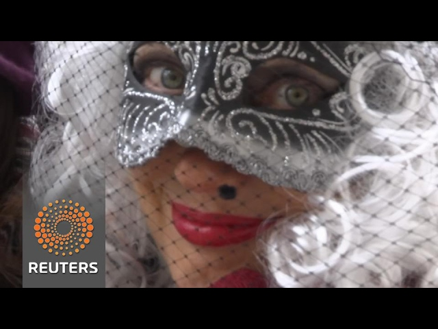 Venice welcomes masked revellers for its lush carnival. Rough Cut (no reporter narration).