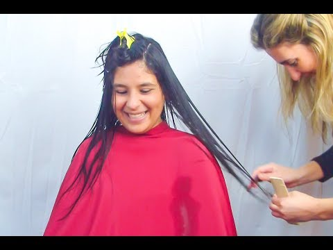 Haircut layering a very long hair of a nice brunette
