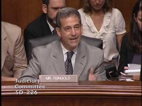Feingold Questions Department of Justice Officials on PATRIOT Act