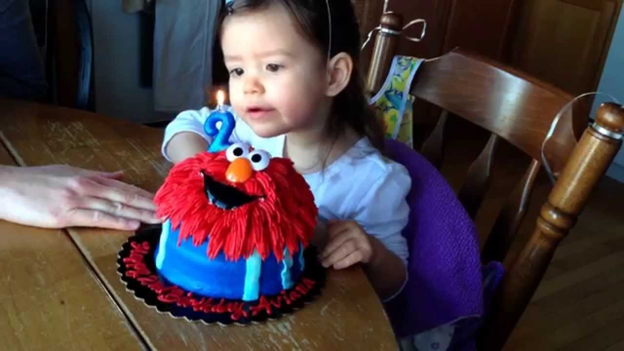 Avi gets to blow out her candle on her Elmo cake on 2nd birthday