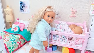 Mommy and twin baby dolls family routine in dollhouse with toys