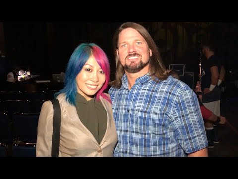 AJ Styles wishes Asuka luck prior to a special Connor