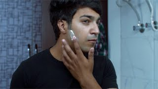 Handsome Indian man applying shaving cream on the face with a finger
