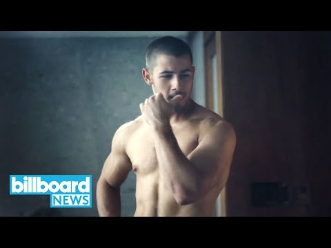 Nick Jonas Wants Everyone to Know He's Single & Flaunts His Abs on Men's Fitness | Billboard News