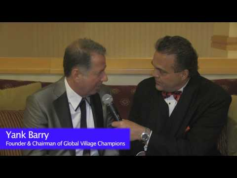 Nick Lowery with Yank Barry discussing Global Village Champions
