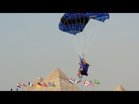 Skydivers fly over Giza Pyramids in Egypt's first air sport festival