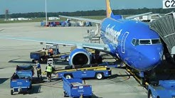 Baggage Handlers At Jacksonville International Airport Throwing Luggage