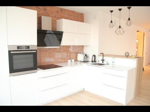 белая угловая кухня в эксплуатации фасады белый глянец мдф