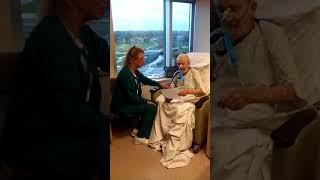 Nurse Brenda singing to dad
