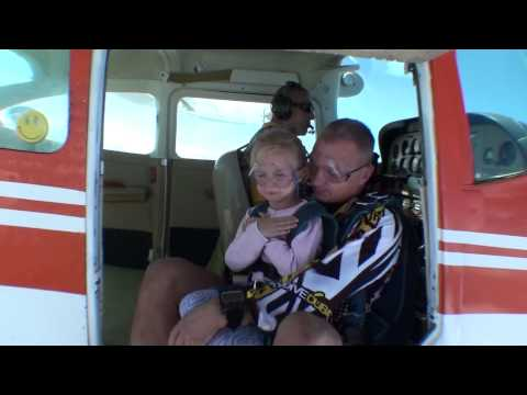 Dad skydiving with 5 years old daughter
