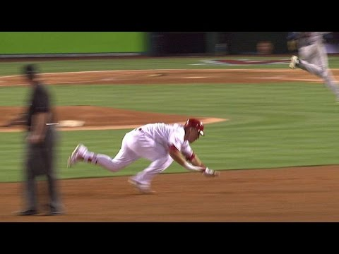 Trout trips rounding second base