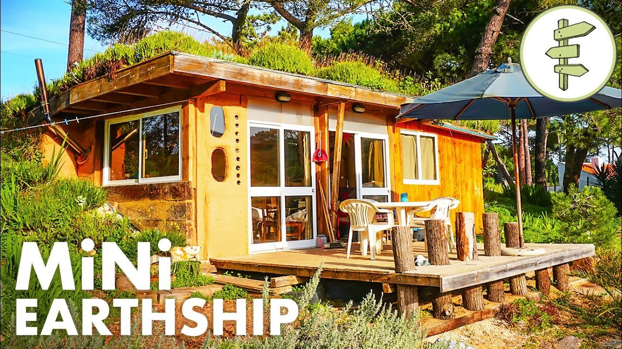 Tiny Earthship Style Cabin Built With Recycled Tires Green Roof