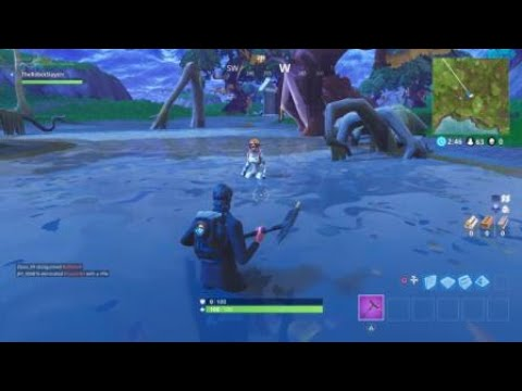 Fortnite Search Between Vehicle Tower, Rock Sculpture, and Circle Of Bushes