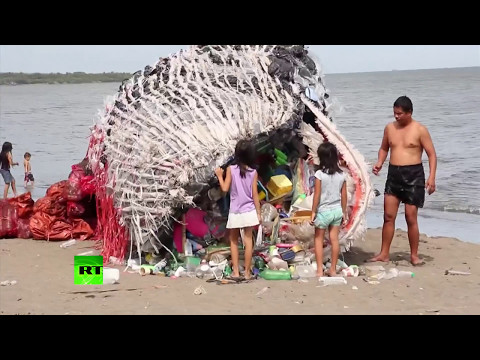 'Listen to the dead whale's wake-up call': Giant plastic sculpture highlights pollution of the sea