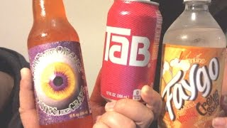 Taste test AMERICAN DRINKS!: Faygo creme soda, Tab, Looks like orange but tastes like grape