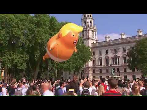 Protesters in London flew a giant balloon depicting US President Donald Trump as an angry baby. Trump told the newspaper 'The Sun' that he felt unwelcome in London because of protests. (The Associated Press)