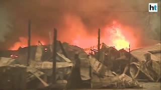 California fire destroys thousands of structures, residents scramble to flee
