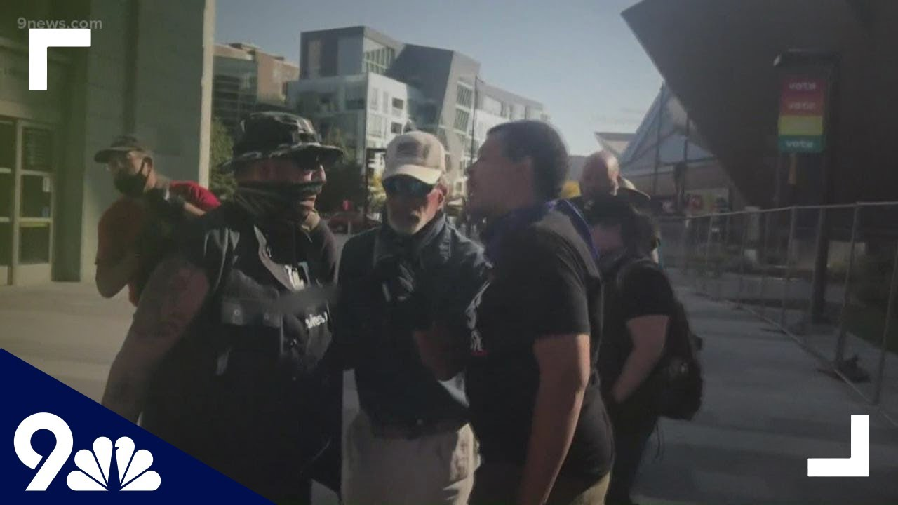 Download Video shows moments before, during and after shooting at dueling Denver rallies