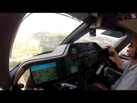 Embraer Phenom 100 landing at Opa Locka (KOPF)