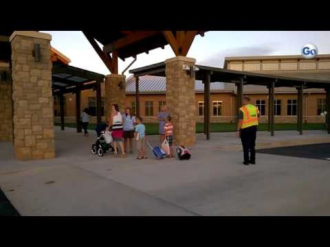 Parents drop off their children for the first day at new Shoally Creek Elementary School in Boiling