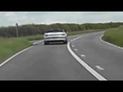Bubble car passing Porsche