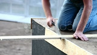 Carpenter Sawing Plank. Stock Footage