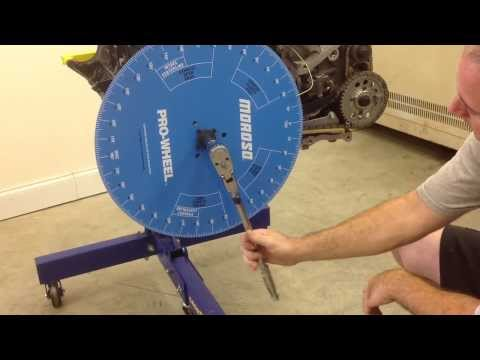 Finding top dead center using the degree wheel and piston stop