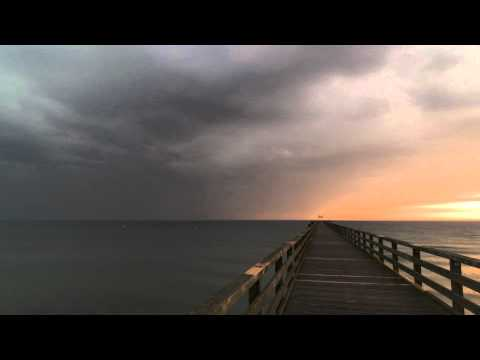 Sunrise and thunderstorm at the beach (time lapse)