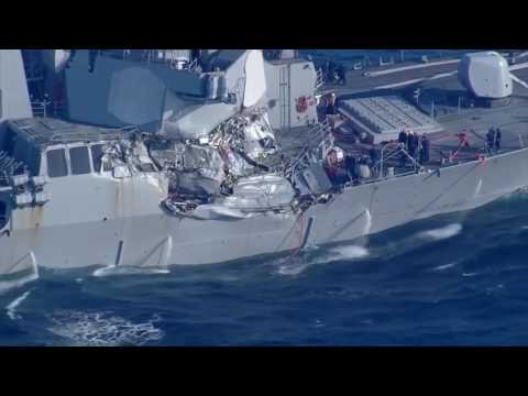U.S. Navy destroyer collides with container ship near Japan, suffers damage