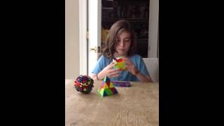 dalia solving the rubrics cube pyraminx and gear ball