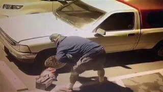Thief with tattoo stealing my car battery caught on camera
