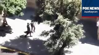 Polislər keçərkən polis men saxlama məni mahnısı seslendirildi