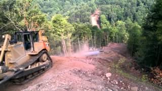 Repeat youtube video Dozers bail off hill on Sheehan pipeline
