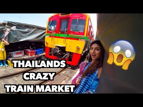 THAILANDS CRAZY TRAIN MARKET  (Maeklong Railway Market + Damnoen Saduak Floating Markets Bangkok)