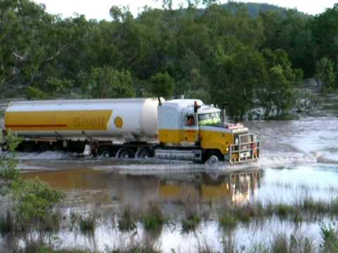 Shell Road Train Crossing a Flooded River