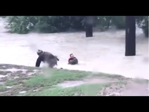 'Get out now!' Levee breaches south of Houston as flooding intensifies