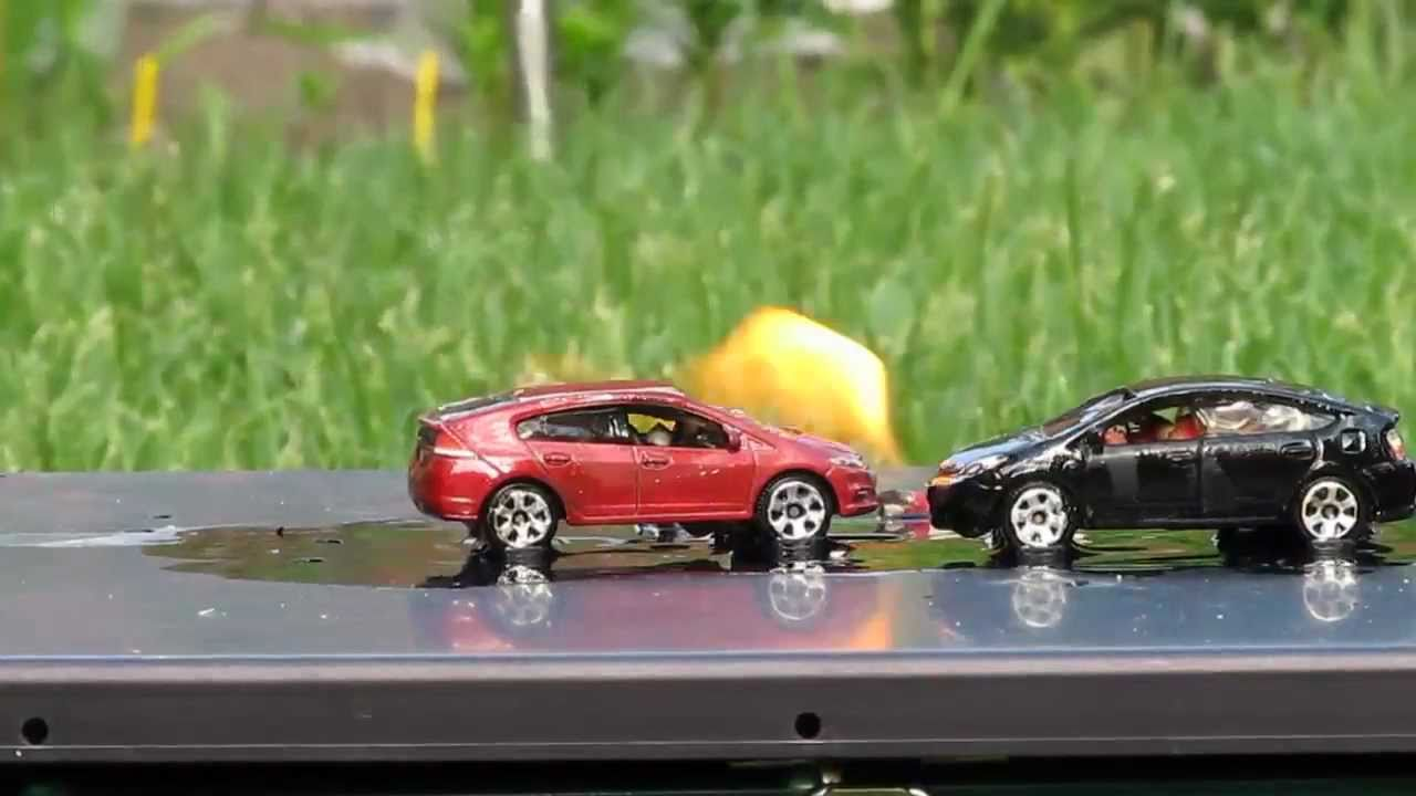 Toyota Prius And Honda Insight On Fire Matchbox Diecast