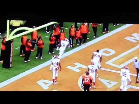 Oklahoma State male cheerleader tries to trip OU player after touchdown