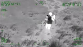 Thermal video shows Michigan State Police helicopter searching for lost hunter