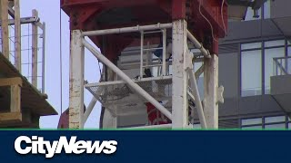 Woman rescued from crane at Lake Shore and Bathurst