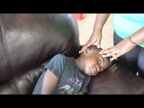 Instilling ear drops in a pediatric patient