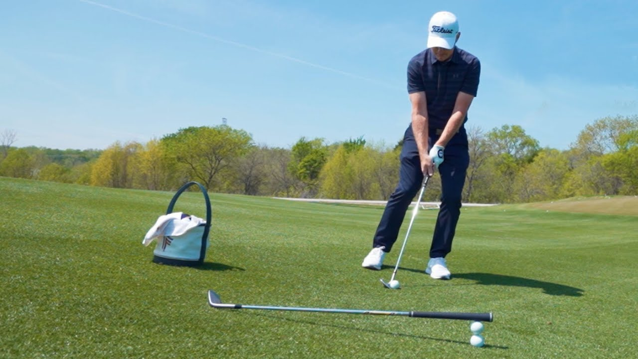 Titleist Tips: Downhill Wedge Off a Tight Lie