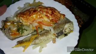 Рыба минтай запечённая с овощами.
