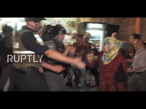 East Jerusalem: Israeli police clash with worshippers protesting security measures at Al-Aqsa Mosque