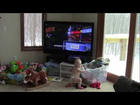 Baby Loves Dancing to Colbert Report Theme Song!