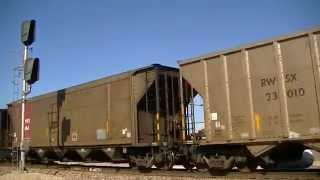 BNSF 6208 leads a southbound coal train.
