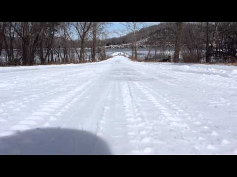 Snow sledding down Plum Point hill